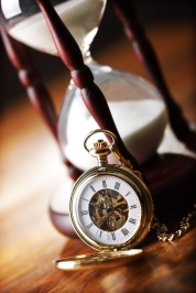 Hour glass or sand timer with vintage pocket watch, symbols of t